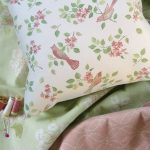 Birds in Blossom pink cushion