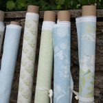 Blue and Green fabric rolls
