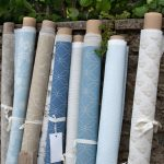 Blue and neutral fabric rolls