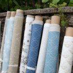 Blue and neutral fabric rolls 2