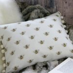 Busy Bee white pompom cushion