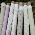 Pink and green fabric rolls