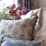 Rose Drop country blue cushion with trim